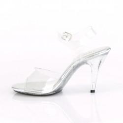 Прозрачные босоножки на низком каблуке покрыты мелкими блёстками